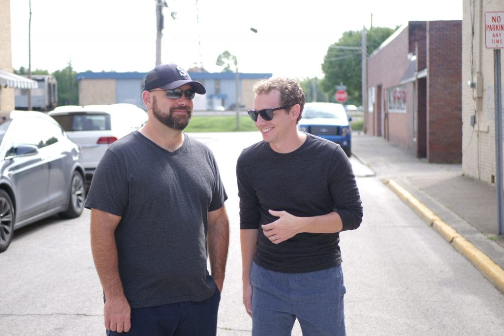 Dan and Dylan outside of a warehouse